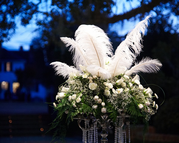 white flowers and feathers